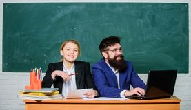 Improving myself through education. paper work. office life. businessman and happy secretary. business couple use laptop. And documents. back to school. formal royalty free stock photo