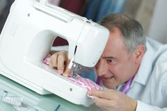 Improving sewing machine features. Improving the sewing machine features Stock Photography
