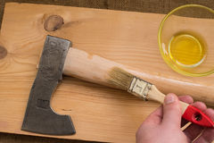Improving tourist axe. Upgrade axe. Paintwork handle axe flaxseed oil, for water resistance. Upgrade axe. Scandinavian ax. tourist hatchet. Improving tourist ax Royalty Free Stock Photo