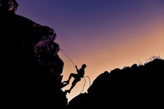 Improvise simple climbing. Climber silhouette; improvise simple climbing Royalty Free Stock Photo
