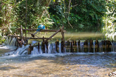 Improvised run-of-stream micro hydro electricity generation. , Laos Royalty Free Stock Photos