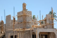Building site with wooden framework and blue sky royalty free stock image