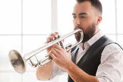 Improvising with his trumpet. Stock Photos