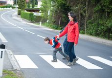 Imptatient Boy with his Family. Crossing the Road Royalty Free Stock Images