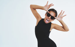 Impudent cheeky young woman sticking out a tongue Royalty Free Stock Images