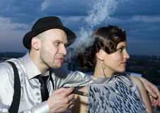 Impudent gangster with retro girl Royalty Free Stock Photo
