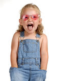 Impudent girl. A little funny girl Royalty Free Stock Images