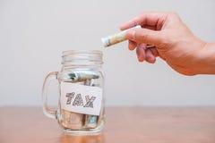 Impuesto sobre la renta de la paga Imágenes de archivo libres de regalías