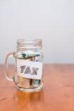 Impuesto sobre la renta de la paga Fotos de archivo libres de regalías