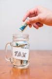 Impuesto sobre la renta de la paga Fotos de archivo