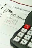 Impuestos calculadores Imagen de archivo libre de regalías