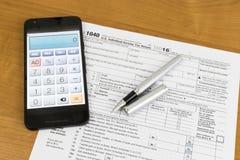 Impuestos calculadores Fotos de archivo