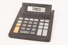 Impuestos de la calculadora Imagen de archivo