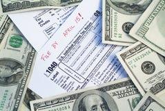Impuestos de la paga Imágenes de archivo libres de regalías