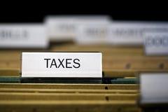 Impuestos etiquetados de la carpeta de fichero imagen de archivo