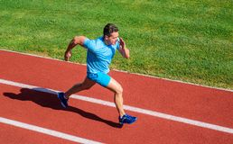Impulse to move. Athlete run stadium green grass background. Life non stop motion. Runner sporty shape in motion. Sport. Lifestyle and health concept. Man royalty free stock photo