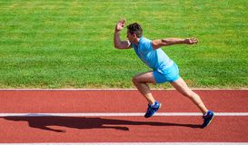 Impulse to move. Life non stop motion. Athlete run stadium green grass background. Runner sporty shape in motion. Sport. Lifestyle and health concept. Man royalty free stock images