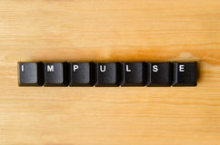 Impulse word. With keyboard buttons stock photography