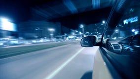 Impulsión de la ciudad de la noche en coche almacen de video
