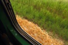 Impulsión del charco de fango a través Imagen de archivo libre de regalías