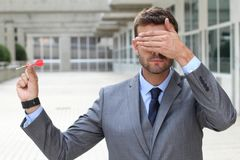Impulsive businessman playing darts in office space.  Stock Photography