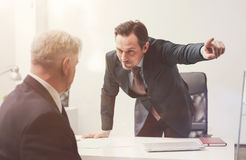 Impulsive stressed executive firing his employee Stock Images