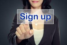 Impulso da mulher para assinar acima o botão imagens de stock