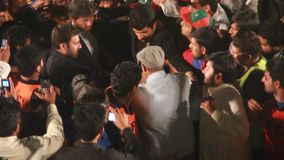 Imran Khan Leaving After Attending Political Rally. Sialkot, Pakistan - Mar 23: Cricketer turned politician Imran Khan leaving stage after addressing to a