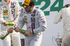 IMSA: Jan 25 Rolex 24. Daytona Beach, FL - Jan 25, 2015: Patrick Dempsey (58) and his team celebrate after winning their division at the Rolex 24 at Daytona stock photos