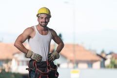 Inżynier budowa Jest ubranym Żółtego hełm Obraz Royalty Free