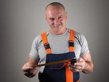 Inżynier w budowie dyszy trzymający pomiarowego narzędzie Zdjęcie Royalty Free
