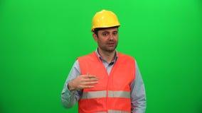 Inżyniera pracownik opowiada przedstawiać o budowie zbiory