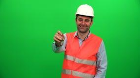 Inżyniera seansu klucze przed zieleń ekranem zdjęcie wideo