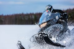Free In Deep Powder Snowdrift Snowmobile Rider Driving Fast Royalty Free Stock Photos - 133347208