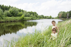Free In The Summer At The Lake Are Small Rural Curly Children In The Royalty Free Stock Photo - 63827095