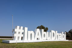 InAbuDhabi twitter hashtag sculpture. #InAbuDhabi twitter hashtag sculpture at the Airport of Abu Dhabi. December 19, 2014 in Abu Dhabi, United Arab Emirates Stock Photos