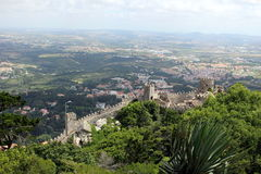 Inaccessible wall of the Moorish fortress against the background of the valley below. Sintra. Inaccessible wall of the Moorish fortress against the backdrop of Royalty Free Stock Images