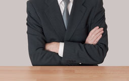Inaction - man at desk with arms crossed Stock Images
