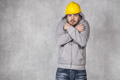 Inadequate clothing worker Stock Image