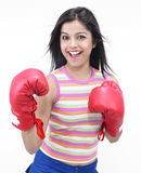 Inadina female boxer. Girl of indian origin with red boxing gloves Stock Photo