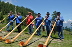 Inalp Nendaz. NENDAZ, SWITZERLAND - JUNE 23: Alpine horn players at the Inalp festival marking the cow herds moving to alpine pastures. June 23, 2012 in Nendaz Stock Image