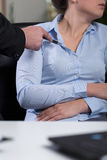 Inappropriate behavior at work. Vertical view of inappropriate behavior at work stock photo
