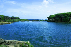 Inarajan Pools Beach. Picture of a natural pool in Guam royalty free stock image