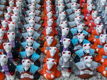 Fox figurines for good luck in Fushimi Inari Taisha shrine. Inari, Japan - nov 6 2017 : at the Fushimi Inari Taisha shrine hundreds of fox statuettes donated as Stock Image