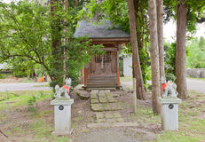 Inari Shinto Shrine, Daisen, Akita Prefecture, Japan. Small worship hall of Inari Shinto Shrine with kitsune fox guards. Located on the grounds of Naganobeyama royalty free stock image