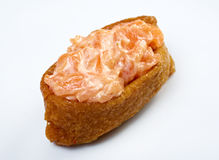 Inari sushi with salmon and roe tobiko Royalty Free Stock Photos