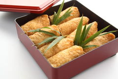 Inari Sushi Wrapped in Fried Tofu in Lunch Box Bento, Japanese Food Stock Photo