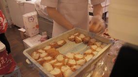 Inarizushi, stuffed tofu skin sushi being prepared stock video footage