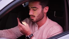 Young Man Using his Cell Phone Driving a Car stock footage