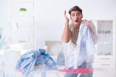 The inattentive husband burning clothing while ironing. Inattentive husband burning clothing while ironing Stock Images